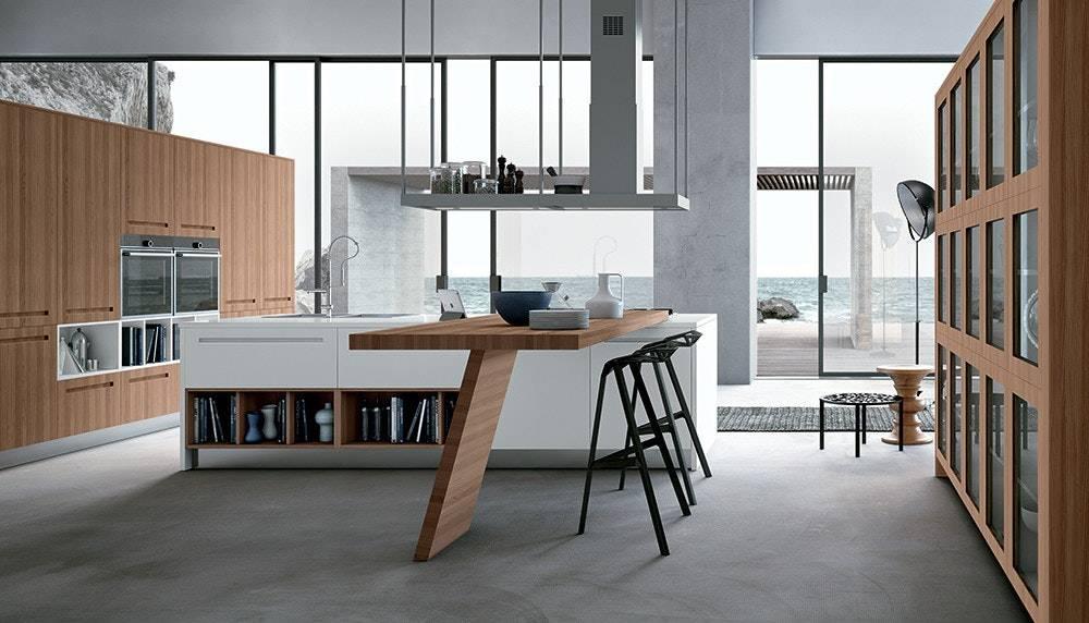 cucina con isola centrale e tavolo